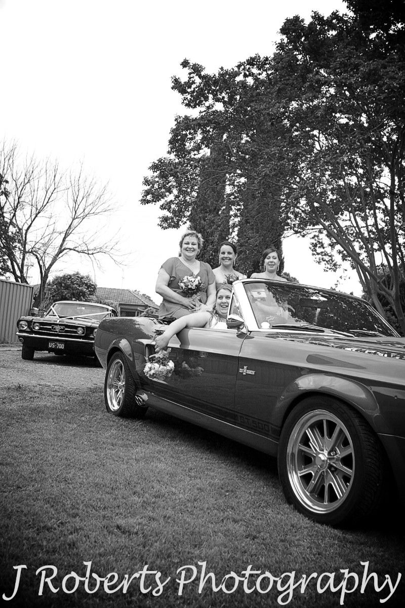 Bride and bridesmaids in Ford GT 500 Mustang - wedding photography sydney