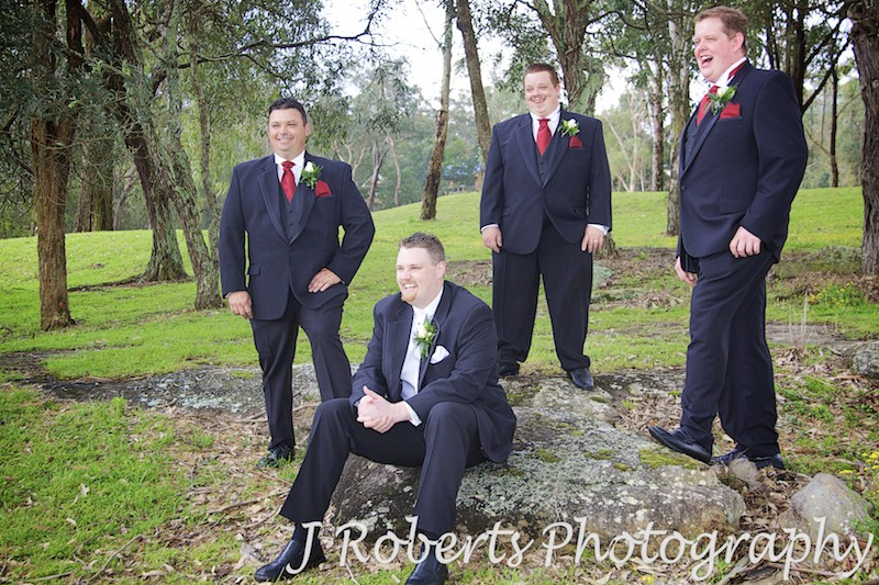 Groom laughing with groomsmen on a golf course - wedding photography sydney