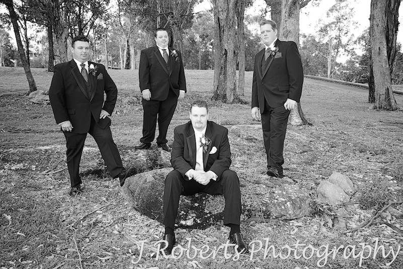 Sepia groom and groomsmen looking serious - wedding photography sydney