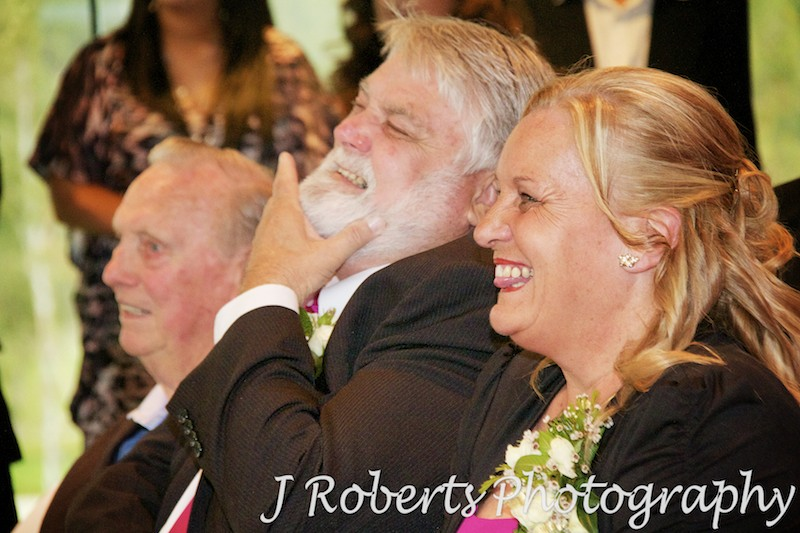 Mother and Father of groom laughing during ceremony - wedding photography sydney