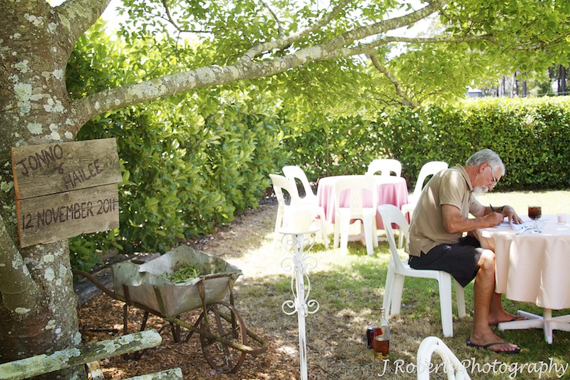 Father of the bride preparing his speech in the garden pre wedding - wedding photography sydney