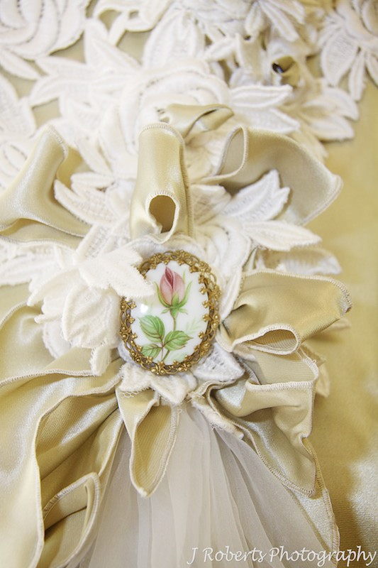Antique brooch détails on wedding dress - wedding photography sydney