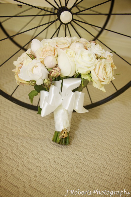 Bridal bouquet with family wedding rings attached - wedding photography sydney