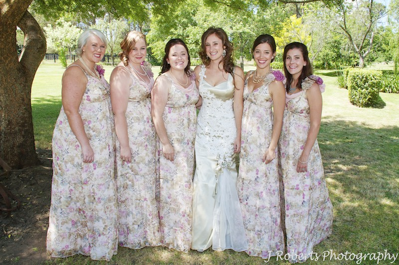 Bride with her bridesmaids in the garden - wedding photography sydney