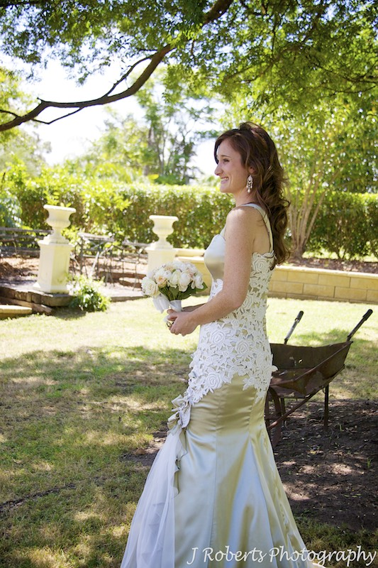 Bride smiling in the garden - wedding photography sydney