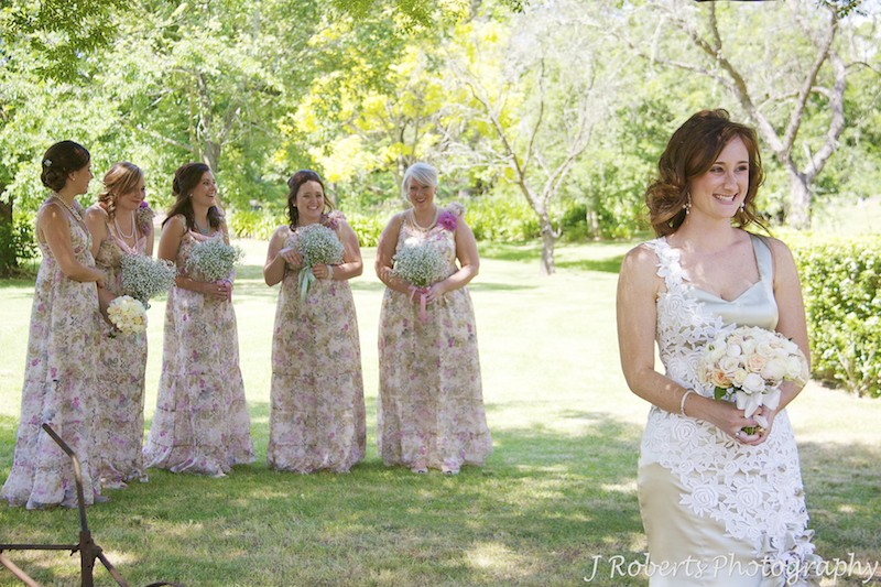 Bride with laughing bridesmaids - wedding photography sydney