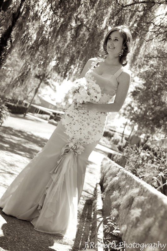 Sepia of bride with mossy bridge - wedding photography sydney