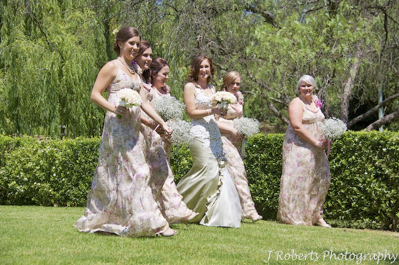 Bride walking in gardens with bridesmaids - wedding photography sydney