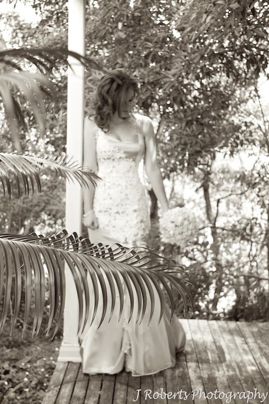 Sepia bride looking down at flowers - wedding photography sydney