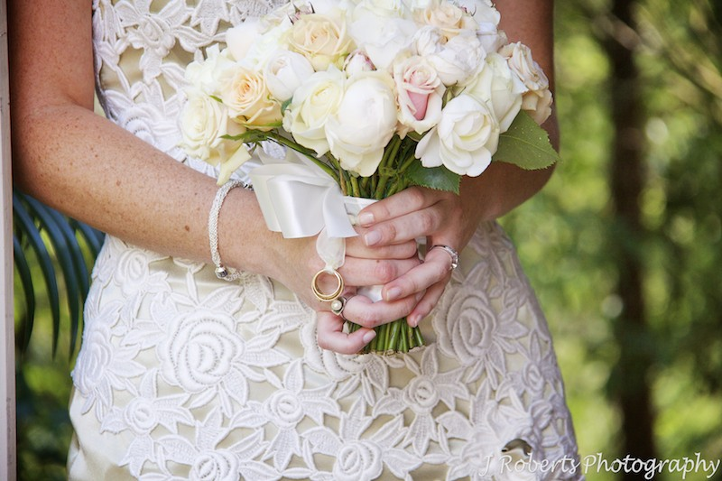 Bridal bouquet with grandparents wedding rings attached - wedding photography sydney