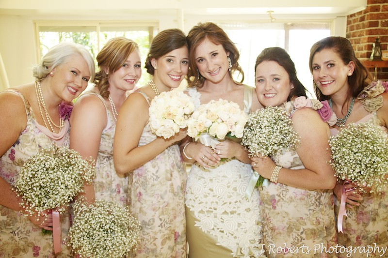 Bride with her bridesmaids in floral dresses - wedding photography sydney
