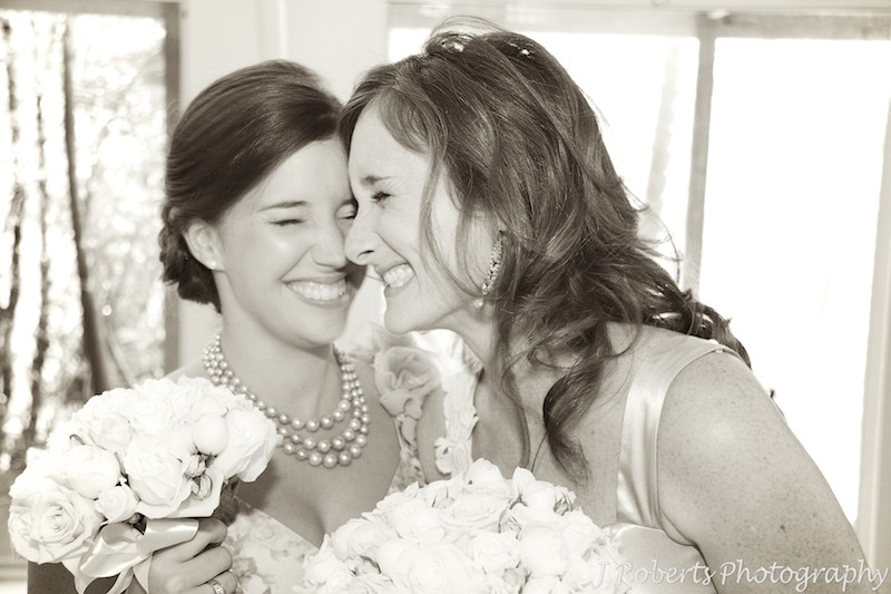 Bride laughing with her bridesmaid - wedding photography sydney