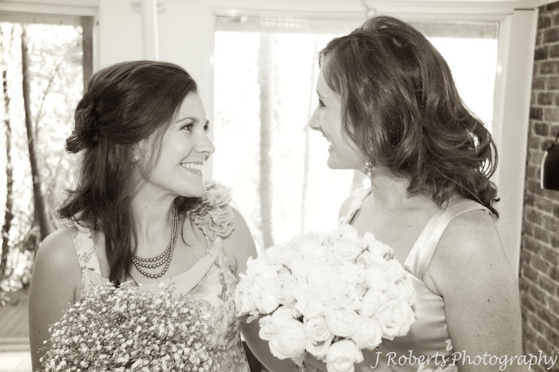 Sepia bride with bridesmaid - wedding photography sydney