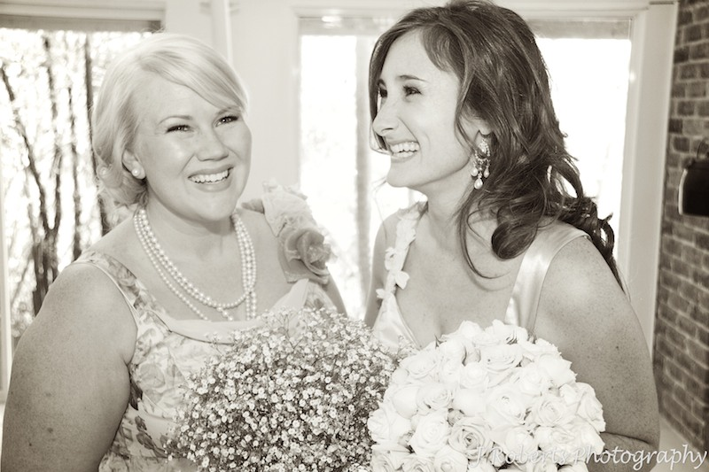 Sepia photo of bride with her bridesmaid - wedding photography sydney