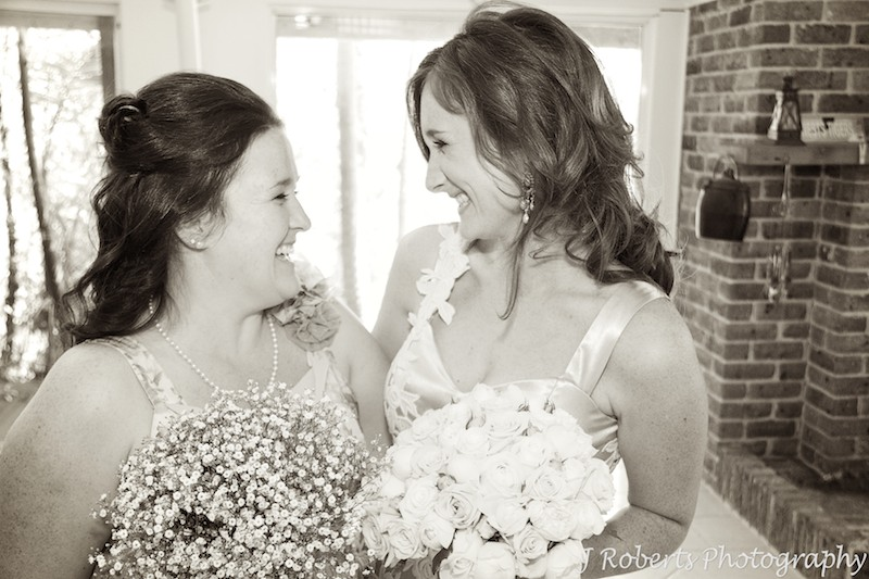 Bride and bridesmaid laughing - wedding photography sydney