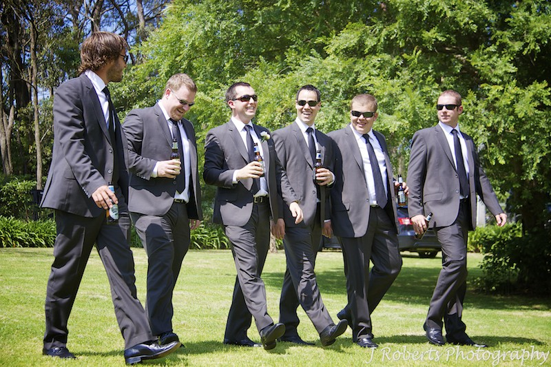 Groom walking with his groomsmen in gardens - wedding photography sydney