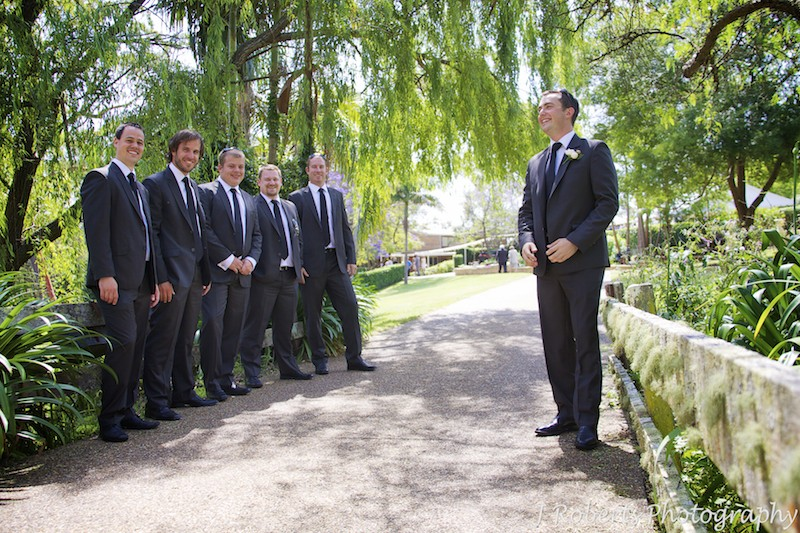 Groom and his groomsmen on rustic country bridge - wedding photography sydney