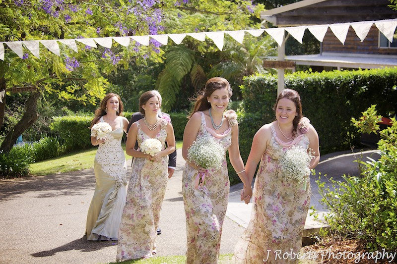 Bridesmaids heading down aisle in garden wedding - wedding photography sydney