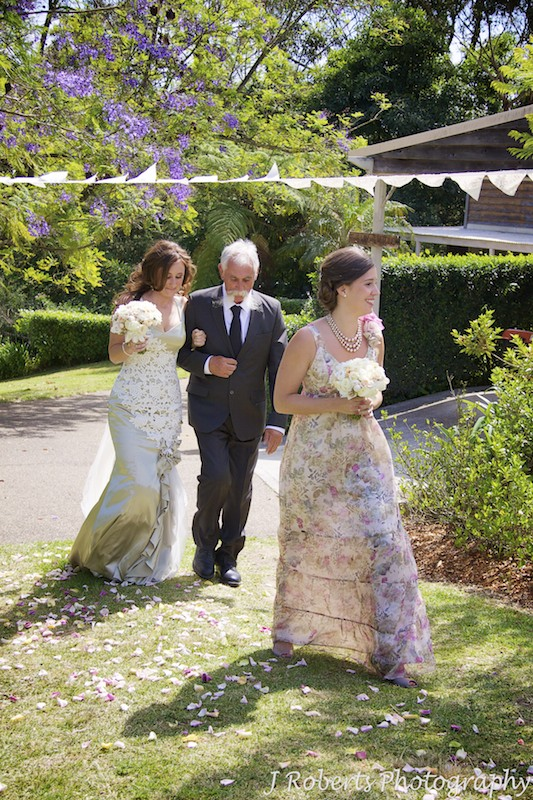 Bride and father heading to aisle in garden wedding - wedding photography sydney