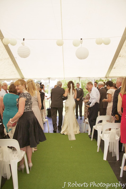 Bride down aisle in garden marquee - wedding photography sydney