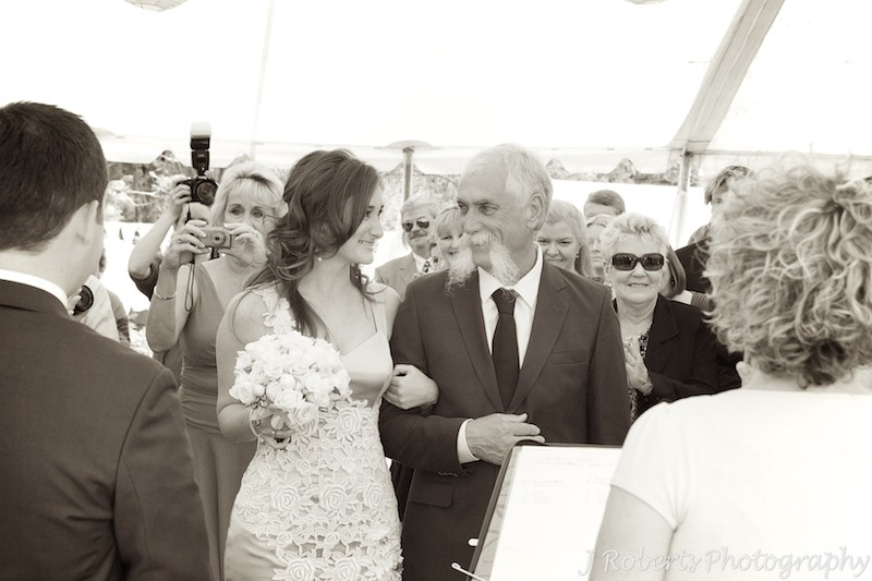 Father of bride smiling at her before he gives her away - wedding photography sydney