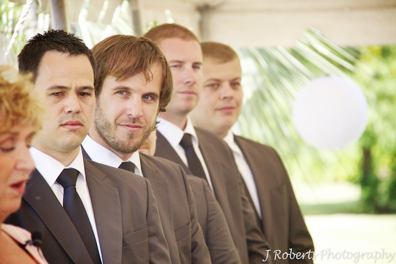 Groomsmen looking on during wedding ceremony - wedding photography sydney