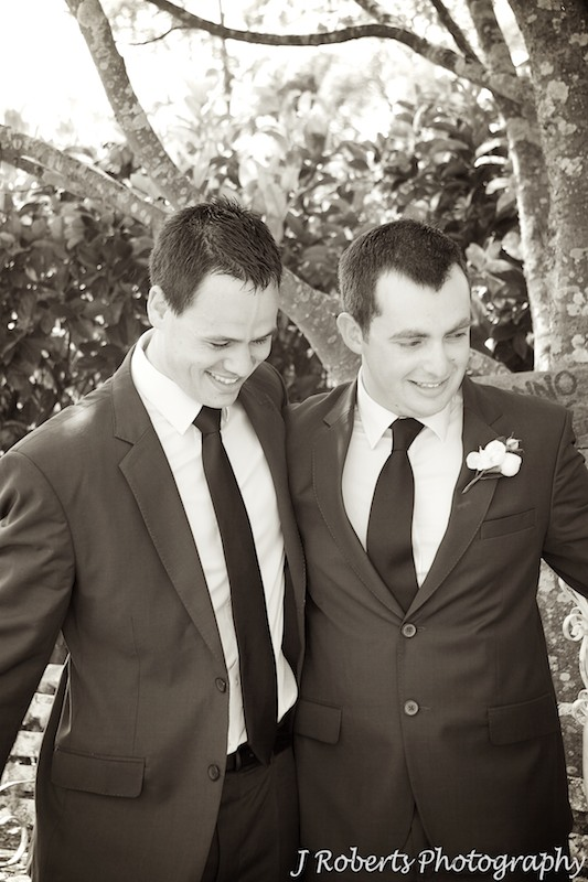 Groom and best man embrace after marriage ceremony - wedding photography sydney