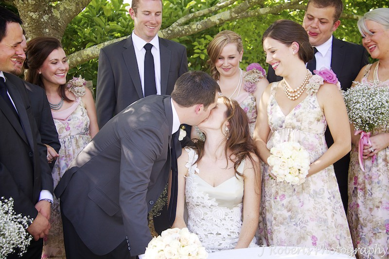 Bride and groom kiss after signing marriage register - wedding photography sydney