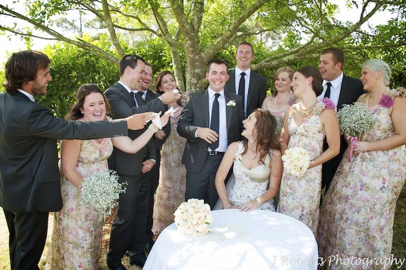 Bridal party offering groom tissues after emotional wedding ceremony - wedding photography sydney