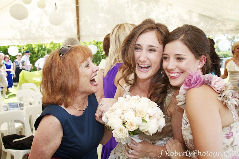 Bride laughing with bridesmaid and friend after marriage ceremony - wedding photography sydney