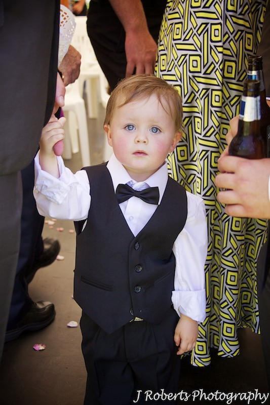 Little boy all dressed up at wedding ceremony - wedding photography sydney