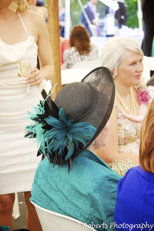 Feather hat at garden party wedding - wedding photography sydney