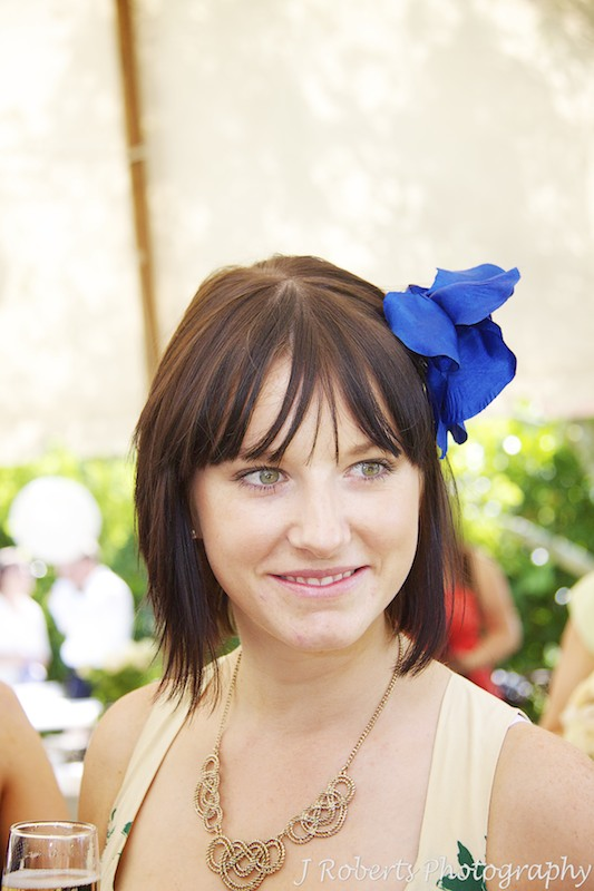 pretty girl with fascinator at garden party wedding - wedding photography sydney