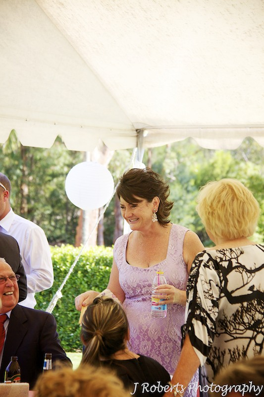Mother of bride laughing with guests at wedding - wedding photography sydney
