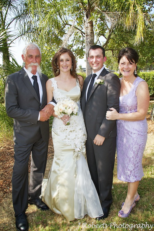 Couple laughing with brides parents - wedding photography sydney