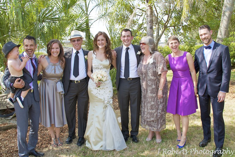 Grooms family laughing at wedding reception - wedding photography sydney