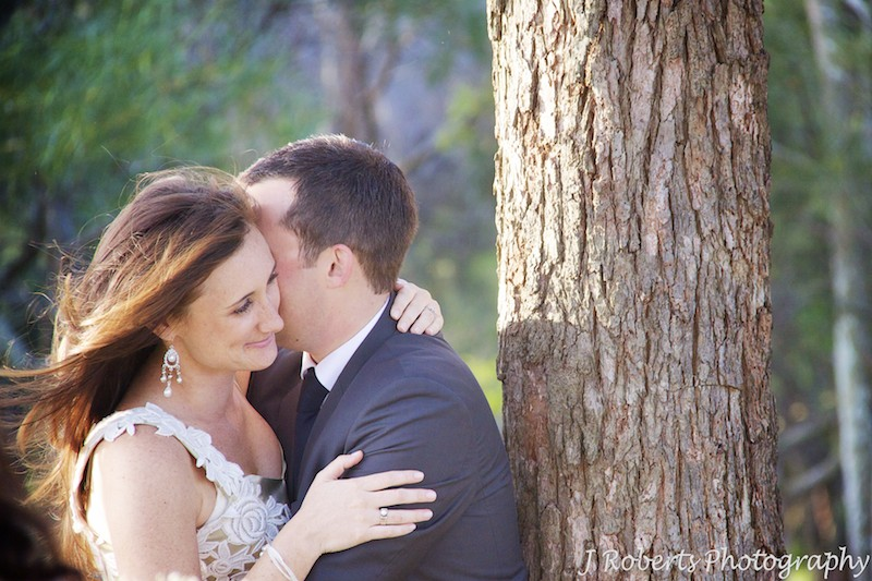 romantic shot of married couple embracing - wedding photography sydney
