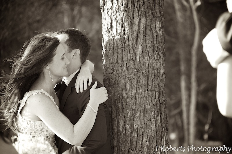 Sepia of couple embracing = wedding photography sydney
