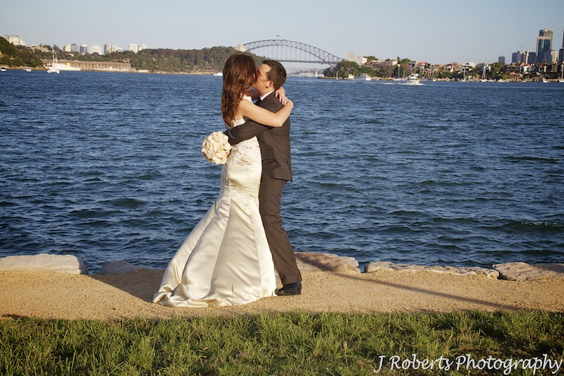 Couple kissing at Clarkes Point Woolwich = wedding photography sydney