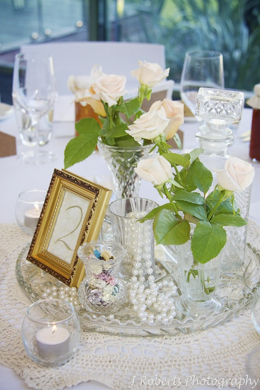 Wedding Table Settings with vases, pearls and roses = wedding photography sydney