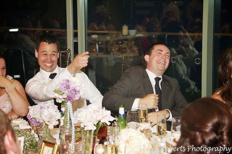 Groom and bestman laughing at wedding speeches - wedding photography sydney