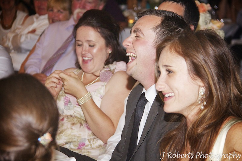 Groom laughing at wedding speeches - wedding photography sydney