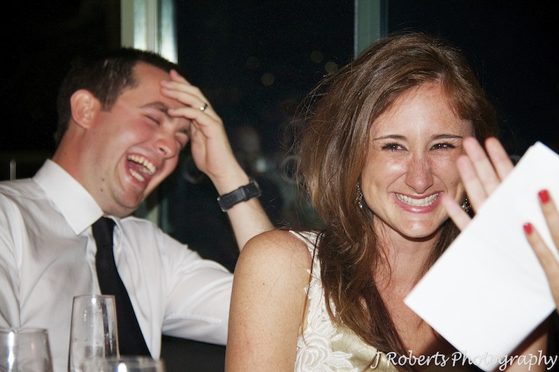 Bride laughing at wedding speeches - wedding photography sydney