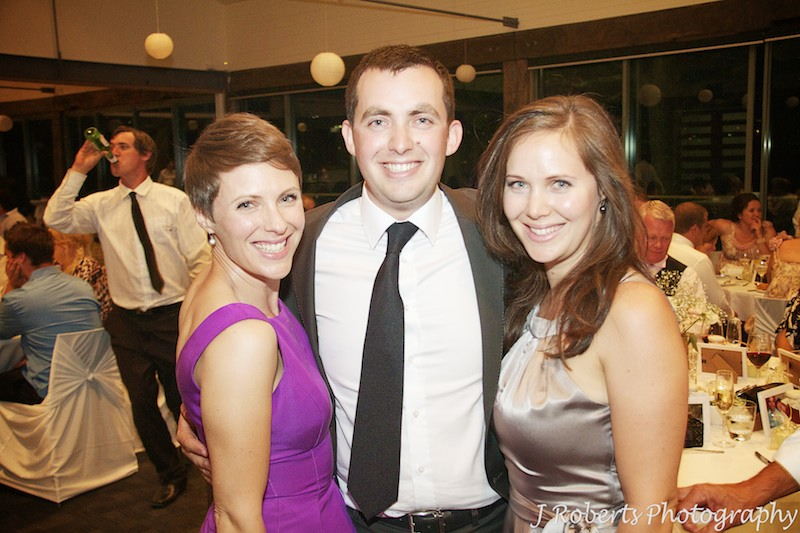 Groom with his sisters at wedding reception - wedding photography sydney