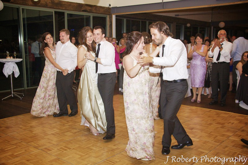 Couple and bridal party on the dance floor - wedding photography sydney