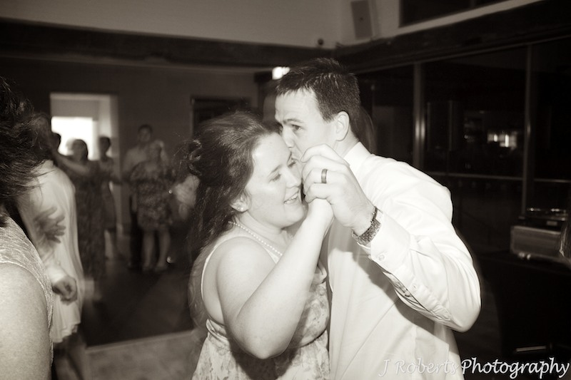 Sepia photo of couple enjoying wedding dancing - wedding photography sydney