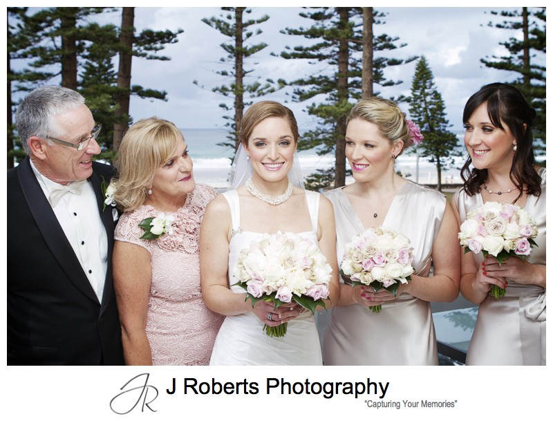 Bride with her family and Manly beach as backdrop - wedding photography sydney