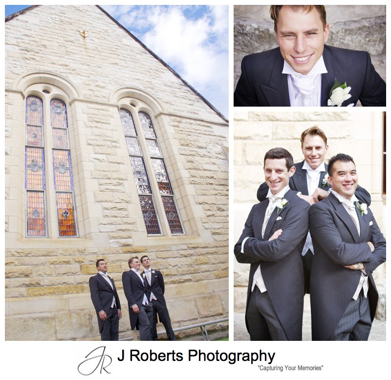 Groom with the sandstone of St Mary's Catholic Church Manly - wedding photography sydney