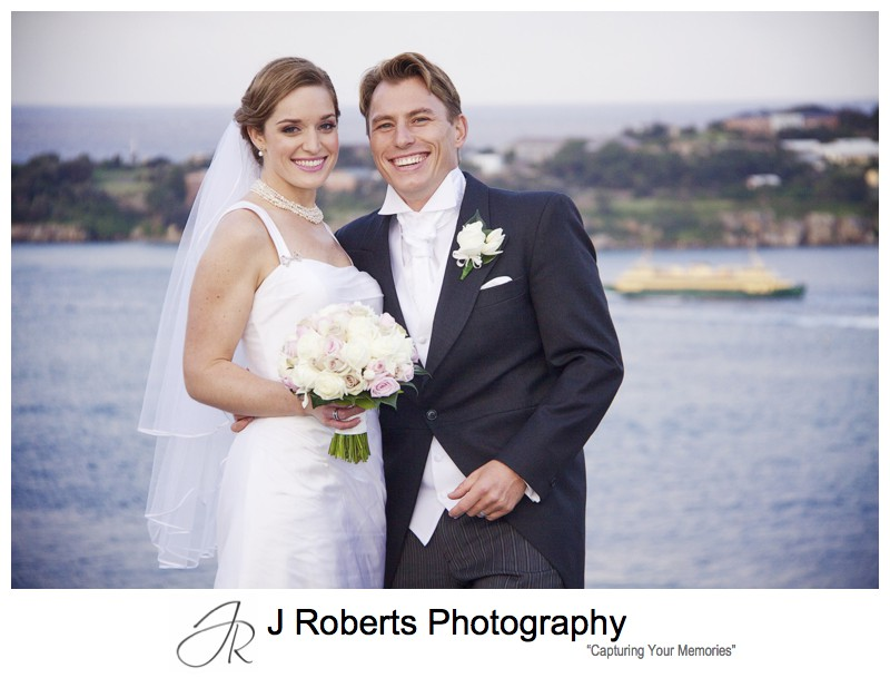 Bride and groom with Sydney Harbour and the Manly Ferry - wedding photography sydney