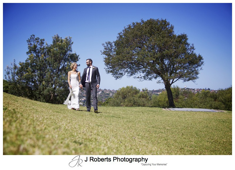 Couple walking hand in hand on Georges Heights - wedding phtogoraphy sydney